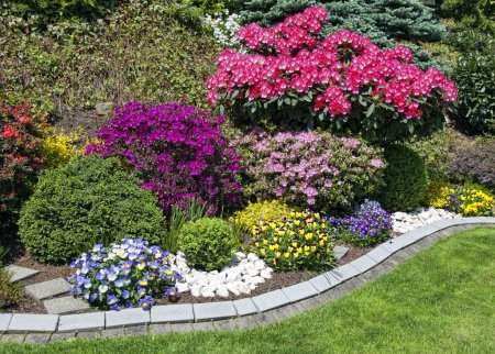 Photo for Landscaped flower garden with lots of colorful blooms - Royalty Free Image