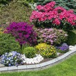 Landscaped flower garden with lots of colorful blo...