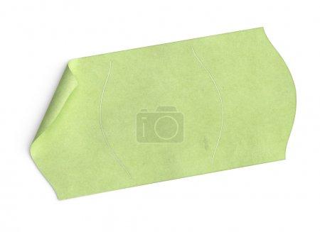 Photo pour Price tag blanc autocollant vert sur fond blanc avec texture et coin plié - image libre de droit
