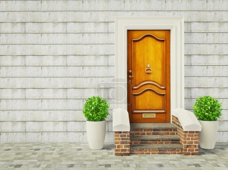 Photo for Vintage door and two plants near wall. - Royalty Free Image