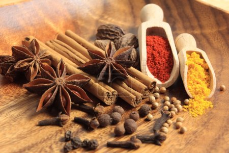 Photo for Cooking ingredients: cinnamon sticks, allspice, clove and star anise. - Royalty Free Image