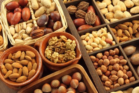 Photo for Varieties of nuts: peanuts, hazelnuts, chestnuts, walnuts, pistachio and pecans. Food and cuisine. - Royalty Free Image