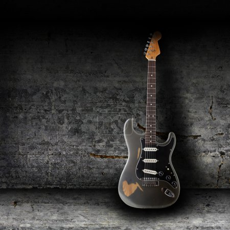Photo for Electric guitar and the wall - Royalty Free Image