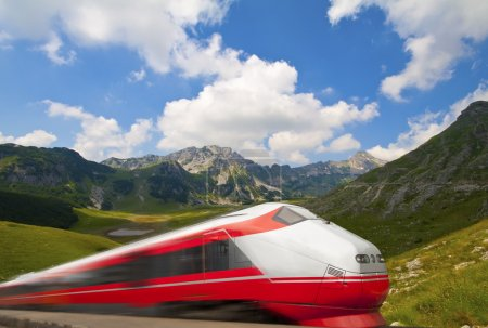 Fast train passing by mountain landscape