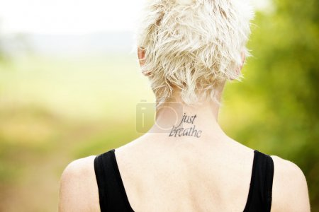Female runner with tattoo on her neck