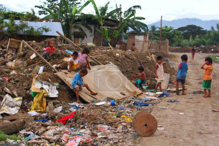 Photo for This street children in Asia makes the dumping area as their play ground - Royalty Free Image