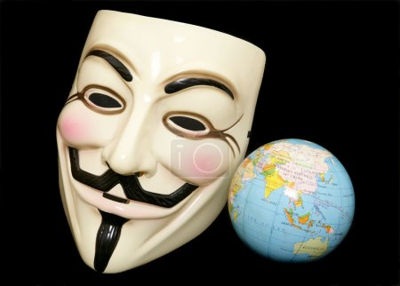 Guy fawkes mask with world globe