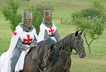 Two medieval crusaders shall strutting