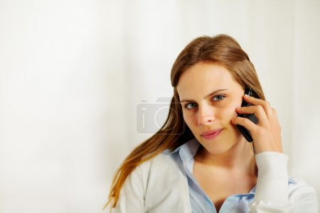 Beautiful businesswoman talking on the mobile phone