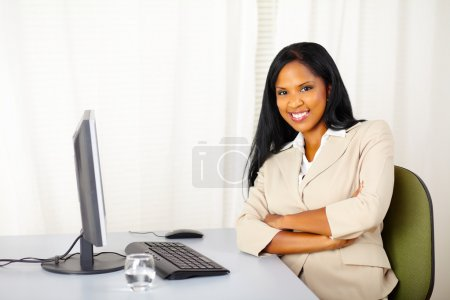 Young confident businesswoman at work