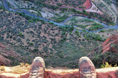 Feet on the edge of rock cliff