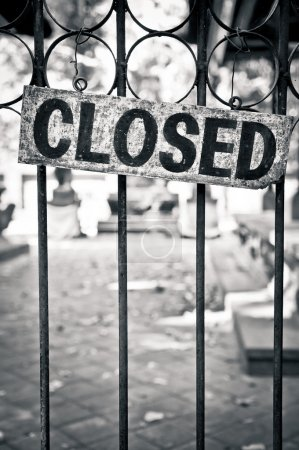 Photo for Closed sign on metal door bars - Royalty Free Image