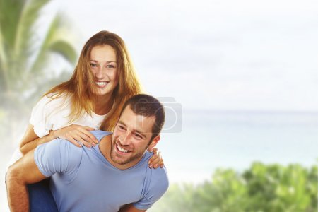Portrait of a happy young couple having fun together in beach