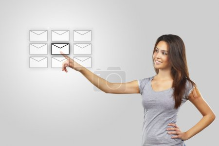 Businesswoman pressing messaging type of modern icons with virtual background