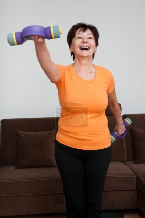 Woman exercising with barbells