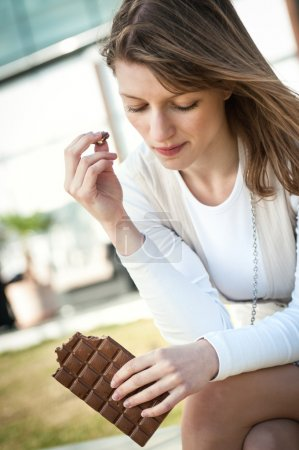 Depression woman eating chocolate