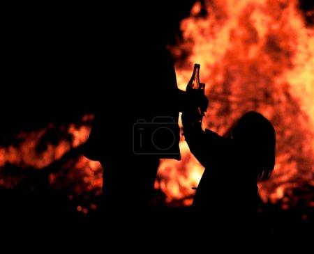 Girl in front of bonfire