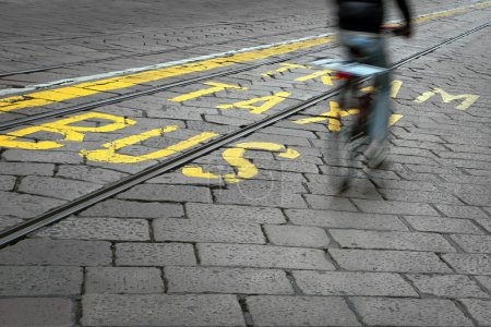 Cyclist and tram track