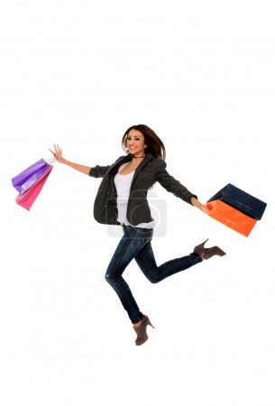 Happy girl holding shopping bags