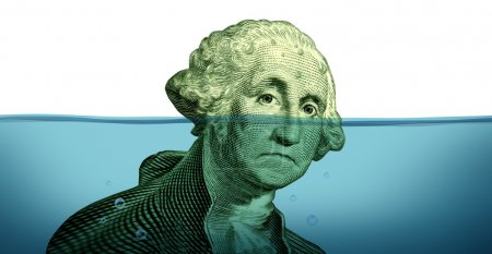 Photo for Debt problems and keeping your financial head above water represented by a drowning George Washington portrait sinking in blue water as a symbol - Royalty Free Image