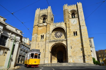 Se Cathedral and Yellow Tram, Lisbon in Portugal