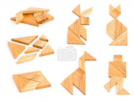 Photo for Isolated views of wooden tangram with few finished figures - Royalty Free Image