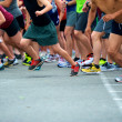 Joggers start race at the moment starting gun is f...