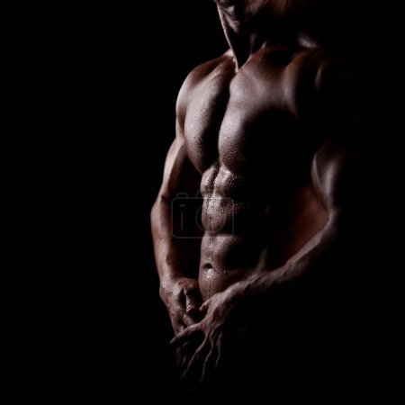 Photo for Strong athletic man on dark background - Royalty Free Image