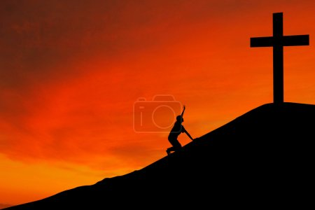Silhouette of man with the Cross