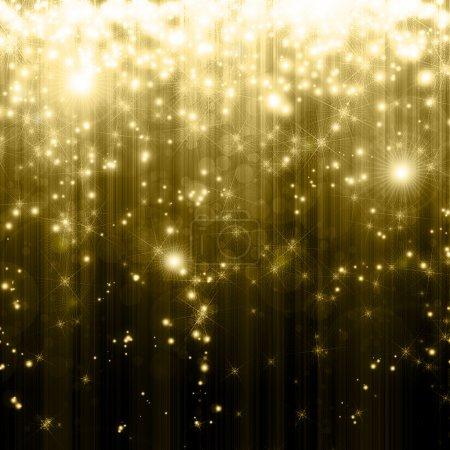 Photo pour Étoiles décroissant sur fond doré - image libre de droit