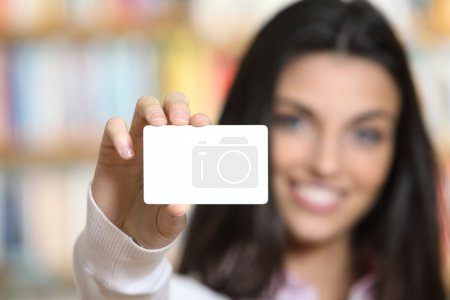 Photo for Smiling young female showing a business card - copy space. - Royalty Free Image
