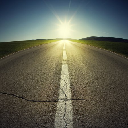 Photo for Asphalt of country road in backlight - Royalty Free Image