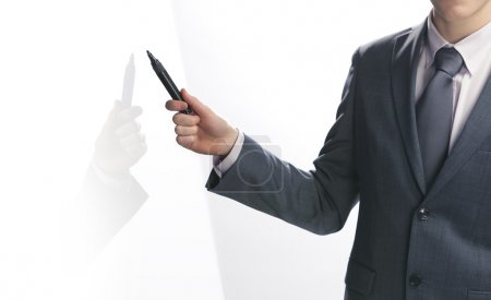 Photo for Businessman pointing to copy space - Royalty Free Image