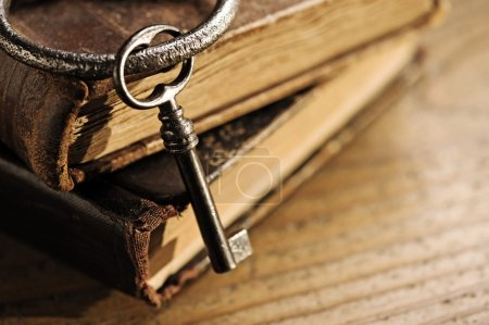 Photo for Old keys on a old book, antique wood background - Royalty Free Image