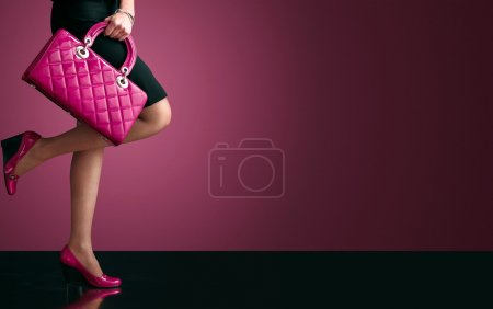 Woman sexy legs with handbag