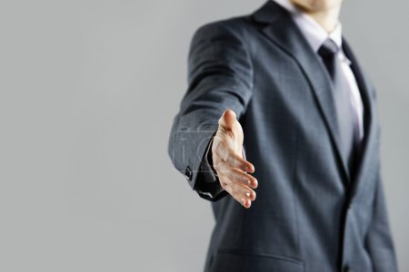 Businessman offering for handshake, close up hand