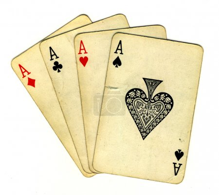 Photo for Four aces (isolated from the background with a clipping path), old used cards - Royalty Free Image