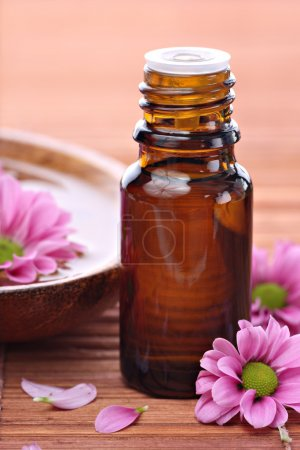 Aromatherapy bottle with pink flowers