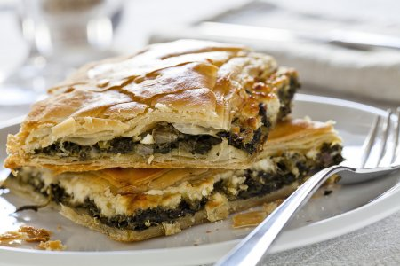 Photo for Close up photograph of two pieces of spinach pie - Royalty Free Image