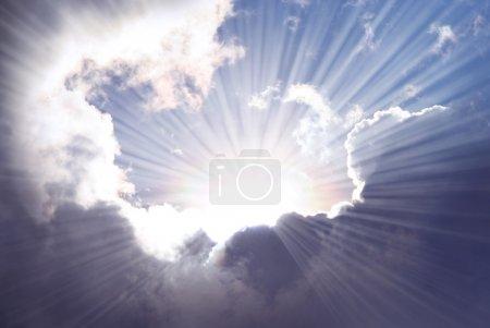Photo for Sunshine rays among dramatic clouds. - Royalty Free Image