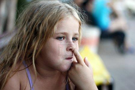 Little girl picking her nose