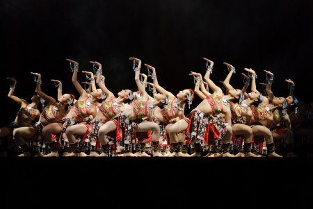 Chinese dancers perform modern group dance on stage