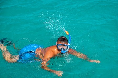 Swimming man in a snorkeling mask
