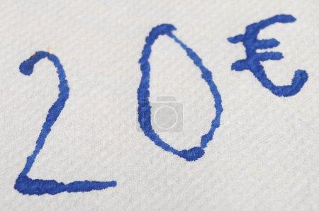 Twenty euros written on white tissue paper