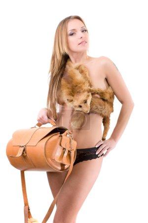 Beauty fashion woman in fox collar fur with animal skin bag