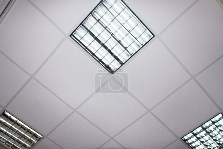 Fluorescent lamp on the modern ceiling, architexture detail