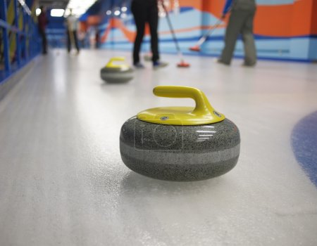 Stones for game in curling on ice.