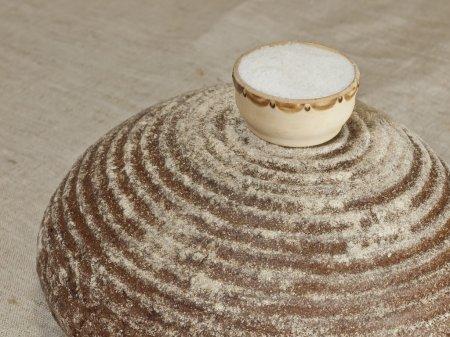 Round rye bread with salt.