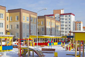 New kindergarten with a playground and new multi-storey building