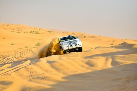 Safari car in yellow desert ,exploison of sand